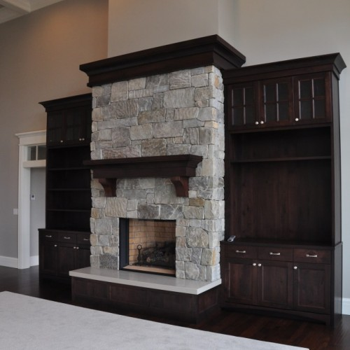 Fireplace surrounded by cabinets